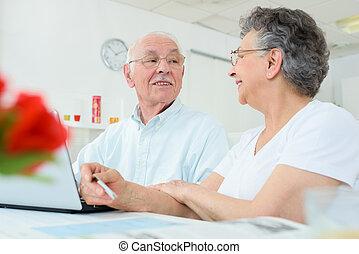 elderly couple having a conversation