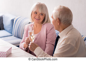 Elderly couple having a romantic lunch - Very cute. Bright...