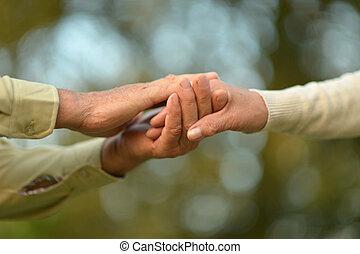 Elderly couple holding