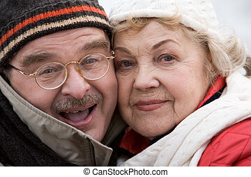 Elderly couple - Image of mature husband and wife looking at...