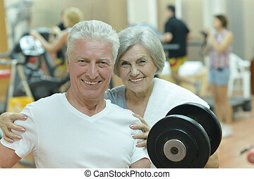 Elderly couple in a gym