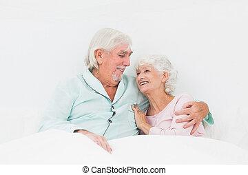 Elderly couple in bed