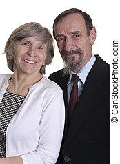 elderly couple in festive clothing