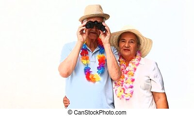 Elderly couple in holidays with bin