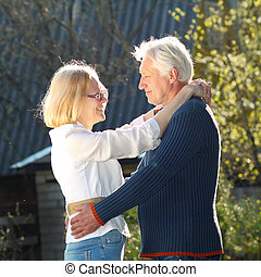Elderly couple in love. Beautiful elderly couple gently embracing at sunset. couple of grandparents embracing