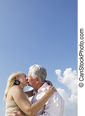 Elderly couple in love, honeymoon with old man and woman kissing. Copy space