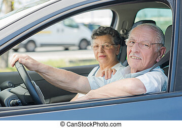 elderly couple in the car