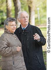 Elderly couple in the woods