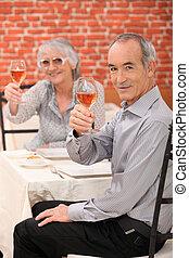 Elderly couple making a toast