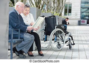 elderly couple on bench