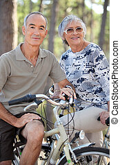 Elderly couple on bike ride