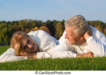 elderly couple on grass