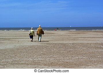 Elderly couple on the beach.