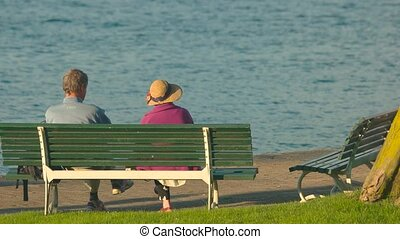 Elderly couple on the bench.