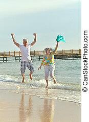 Elderly couple on the shore