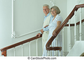 Elderly couple on the stairs