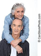 Elderly couple on white background