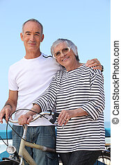 Elderly couple out for a bike ride