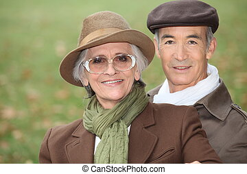 Elderly couple out for a stroll on a Sunday afternoon