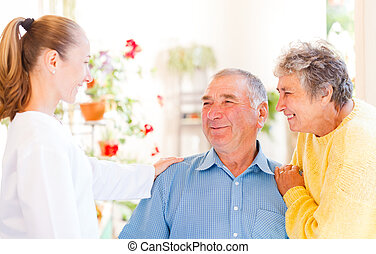 Elderly couple - Happy elderly couple talking with their...