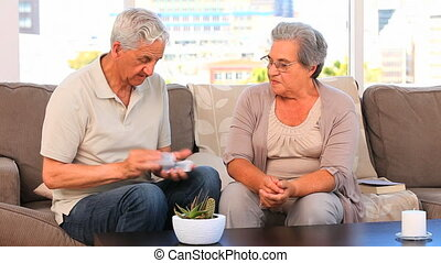 Elderly couple playing cards