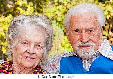 Elderly couple - Portrait of an elderly couple sitting...