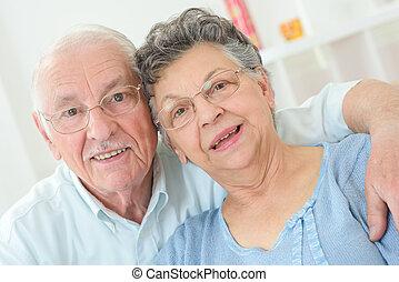 elderly couple posing