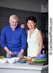 Elderly couple preparing a meal