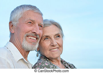 Elderly couple relaxing on a sunny day