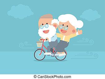 Elderly couple riding vintage bicycle