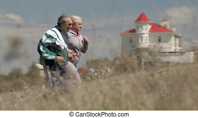 Elderly couple runs together