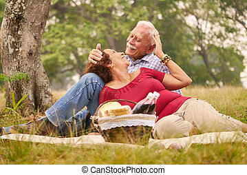Elderly Couple Senior Man And Woman Doing Picnic