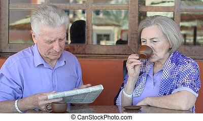 elderly couple sitting at a table