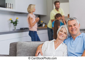 Elderly couple sitting on the couch