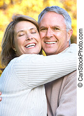 Elderly couple - Smiling happy elderly couple in summer...