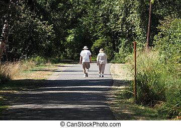 Elderly couple taking a walk in a park