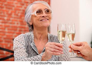 Elderly couple toasting in restaurant