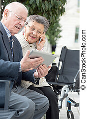 Elderly couple using modern technology