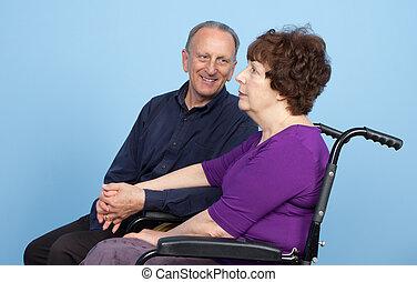 Elderly couple waiting