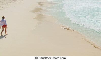 elderly couple walking along beach 001 part I