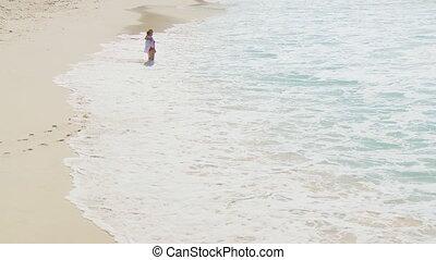 elderly couple walking along beach 001 part II
