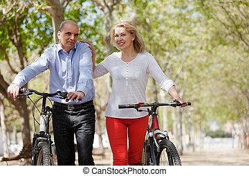 Elderly couple walking in a summer park