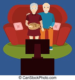 Elderly couple watch TV
