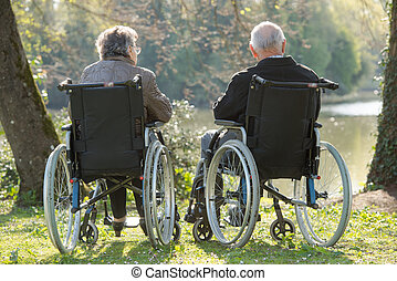 elderly couple watching a lake