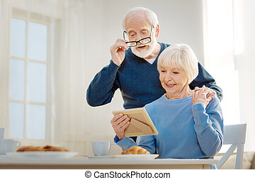 Elderly couple watching their photo