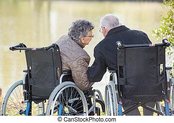 elderly couple whispering