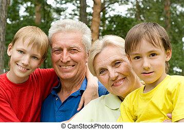 elderly couple with their grandchildren