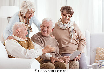 Elderly couples using technology