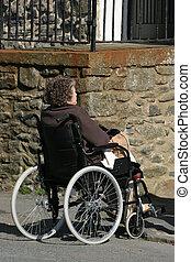 Disabled elderly female sitting in a wheelchair.