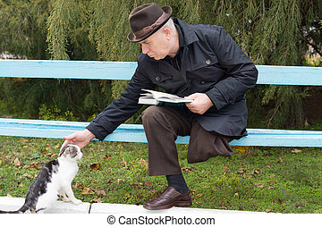 Elderly disabled man stroking a cat